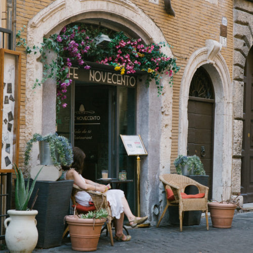 Memorable Jaunts Travel Editorial Photographer Young lady enjoying an outdoor cafe in Rome Italy
